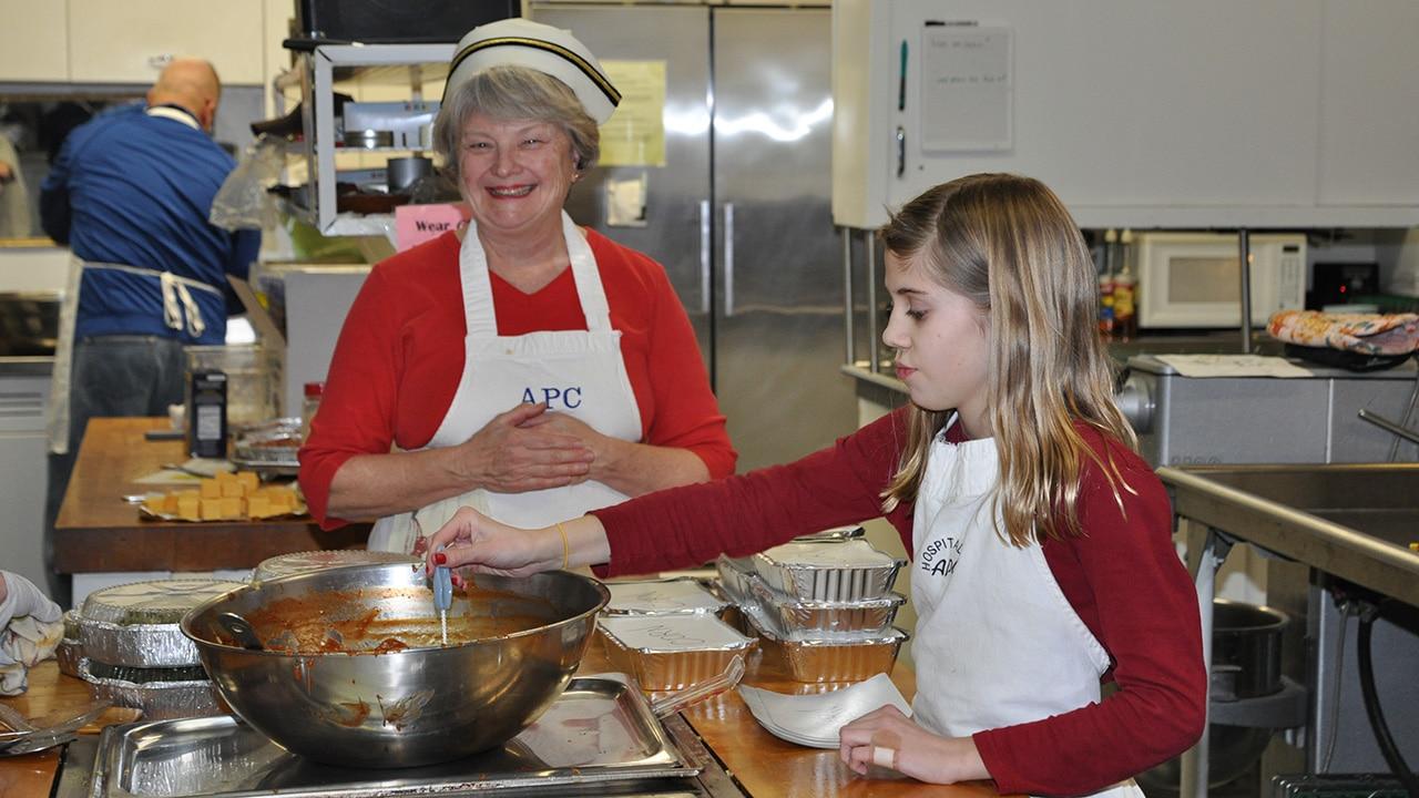 Team serving in kitchen